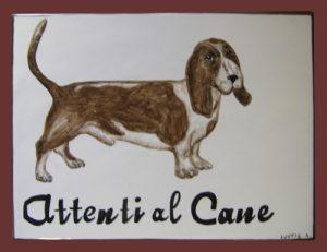Piastrella attenti al cane con bassotto