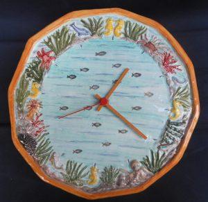 Orologio ceramica fondale marino a rilievo