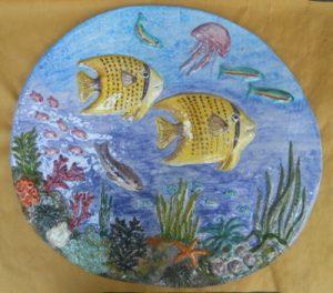 Bassorilievo in ceramica con pesci