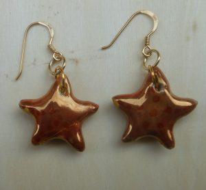 orecchini in ceramica a stellina dorata