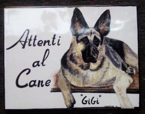 Piastrella con cane dipinto a mano