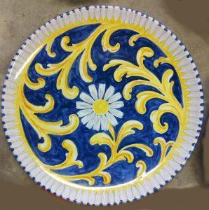 Piatto in ceramica blu notte decoro giallo
