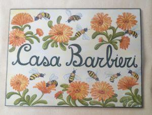 Piastrella con fiori e  api