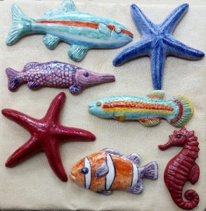 Pesci da appendere a muro in ceramica