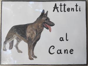 Piastrella con cane pastore