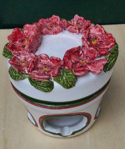 Diffusore in ceramica con fiori rossi