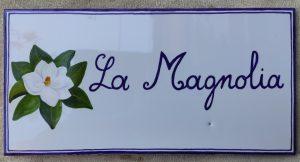 Piastrella targa con magnolia